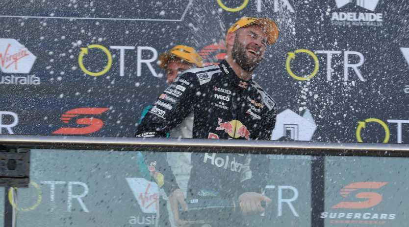 Champagne times for Shane van Gisbergen on the podium after winning at The Bend on Saturday. Picture: Mark Horsburgh