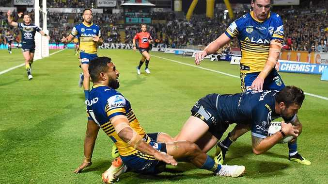Kyle Feldt beats the Parramatta defence to score another try on Friday night. Picture: Ian Hitchcock/Getty Images