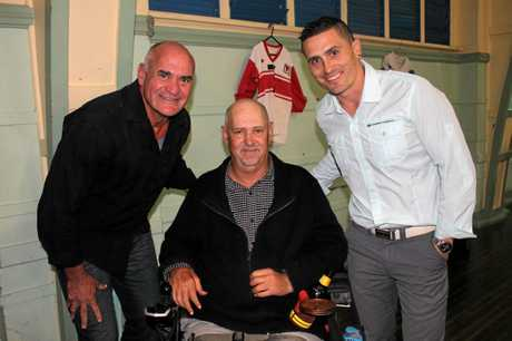 Queensland greats Dale Shearer and PJ Marsh with Ford. His wheelchair was partially funded by the Men of League Foundation as thanks for his contribution to the game.
