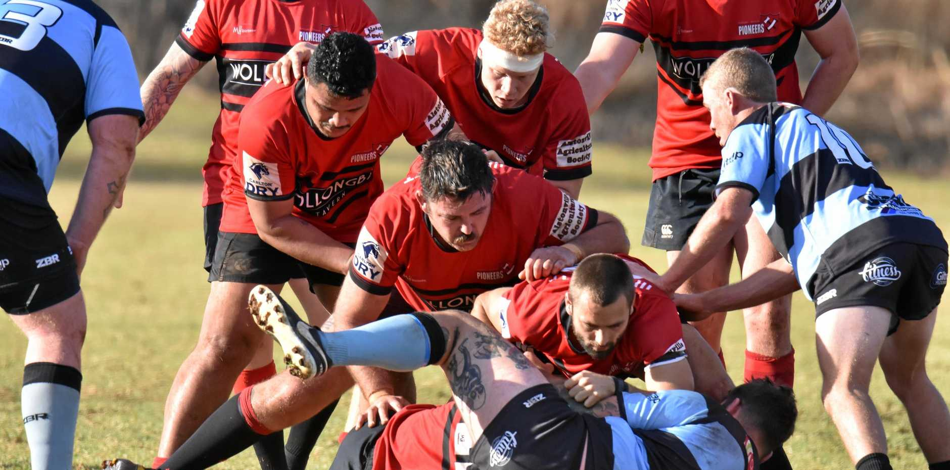 RUCK AND ROLL: Wollongbar forwards try to secure the ball during the Far North Coast rugby union major semi-final between the Pioneers (red) and Ballina (blue).