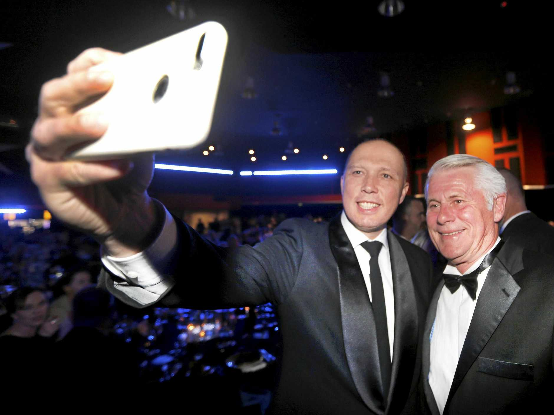 Former Home Affairs Minister Peter Dutton takes a selfie with Tweed MP Geoff Provest at the Police and Community Charity Ball at Tweed Heads on Saturday.
