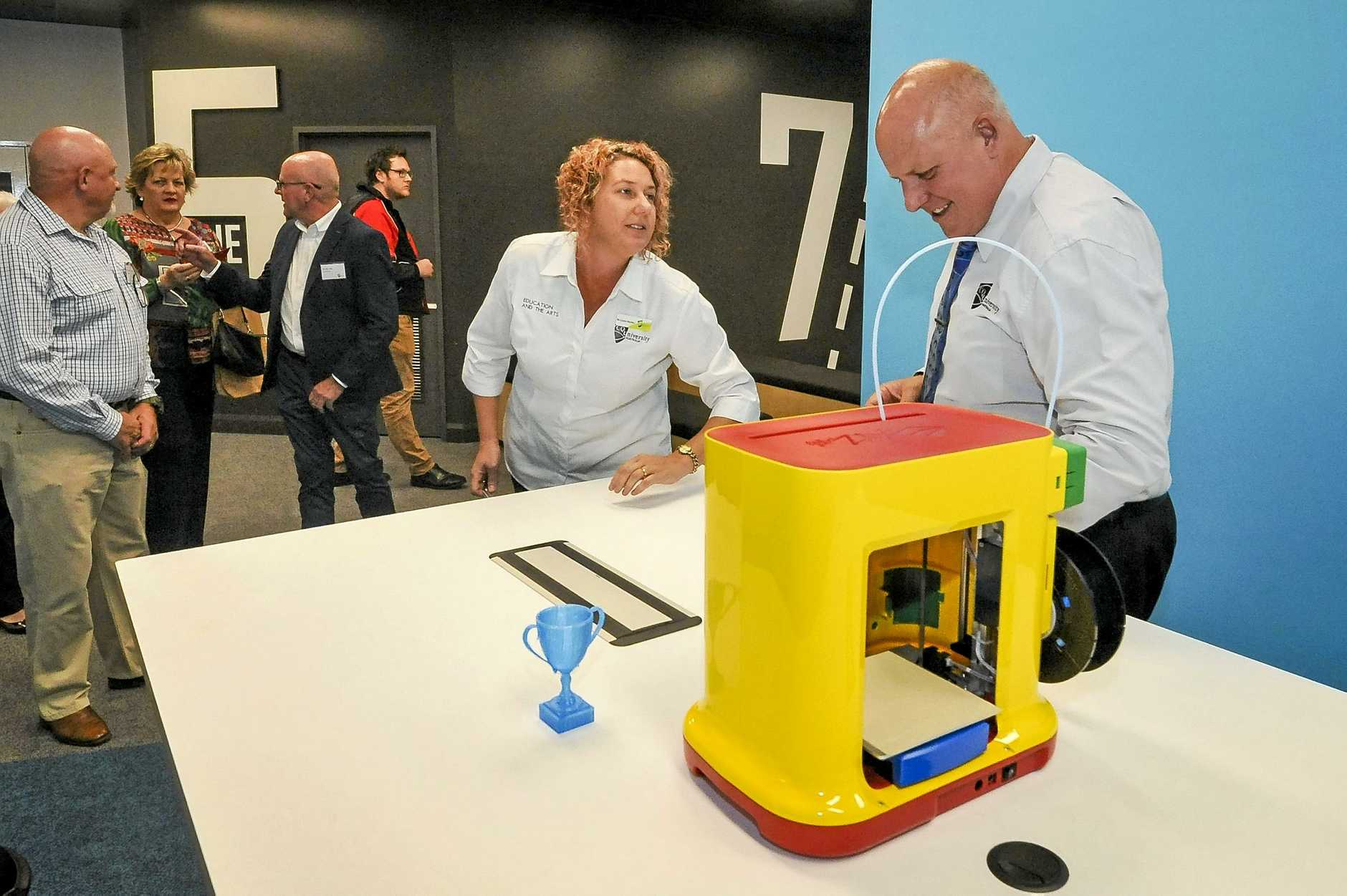 INNOVATIVE: Dr Linda Pfeiffer and CQUniversity vice-chancellor, Professor Scott Bowman, check out the 3D printer at the opening of the Australia Pacific LNG STEM Central at Gladstone Marina campus last Thursday.