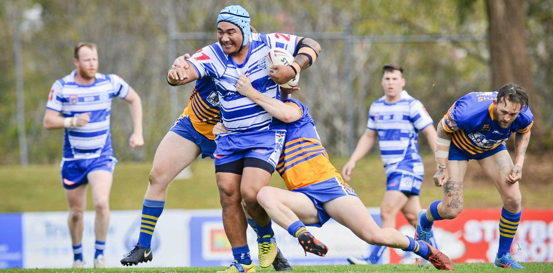 TRUE GRIT: Brothers' Graham Sepulona surges through a tackle during the Reserve Grade major semi-final at North Ipswich Reserve on Saturday.