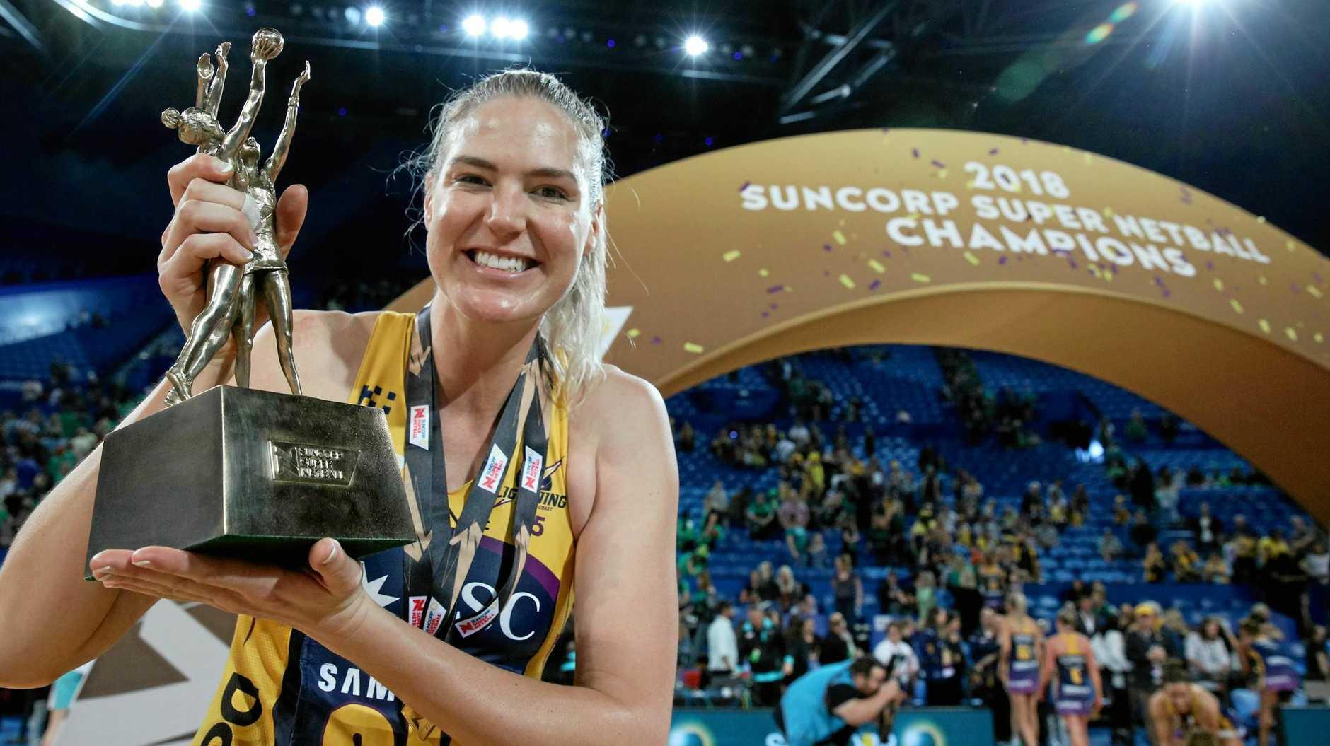CHAMP: Caitlin Bassett of the Lightning holds the trophy after winning the Super Netball grand final.