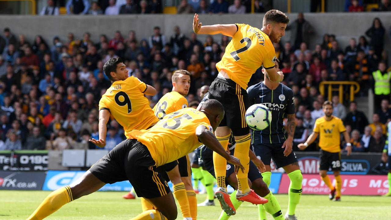 WOLVERHAMPTON, ENGLAND — AUGUST 25: Willy Boly of Wolverhampton Wanderers scores his side's first goal during the Premier League match between Wolverhampton Wanderers and Manchester City at Molineux on August 25, 2018 in Wolverhampton, United Kingdom. (Photo by Shaun Botterill/Getty Images)