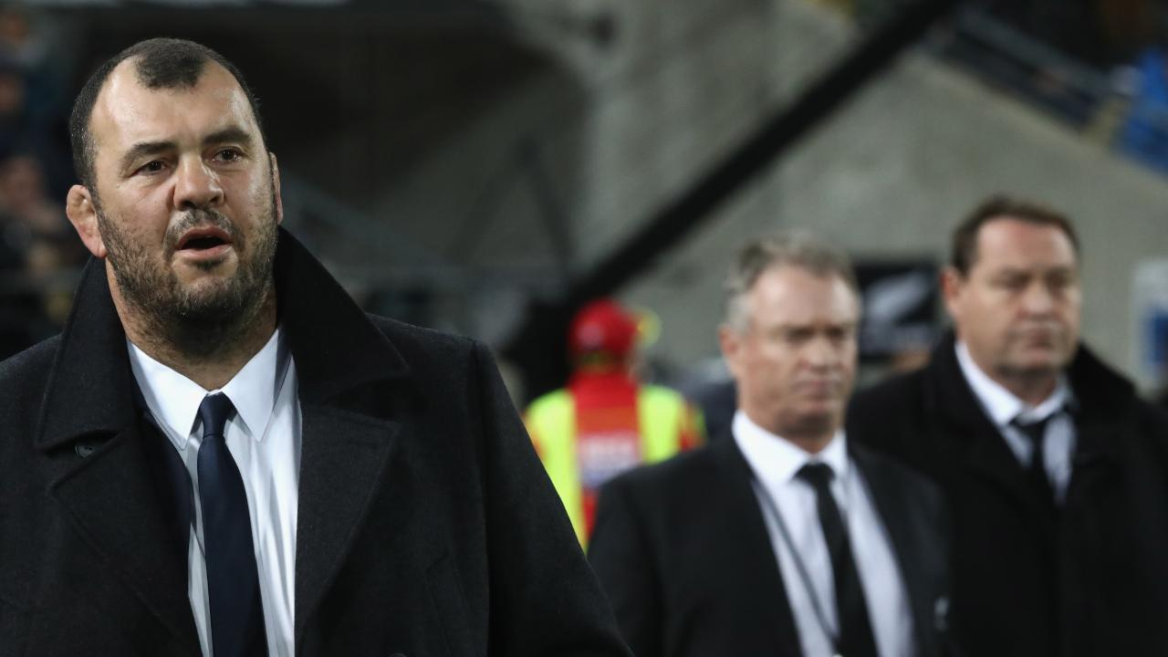 Steve Hansen (R) believes Wallabies coach Michael Cheika shouldn't be under any extra pressure for losing to the All Blacks.