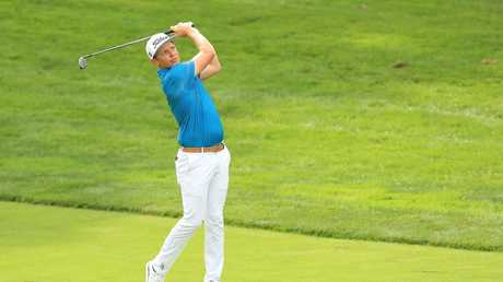 Cameron Smith of Australia plays his third shot.