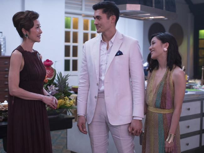 Michelle Yeoh, Henry Golding and Constance Wu in a scene from Crazy Rich Asians. Picture: Sanja Bucko/Warner Bros