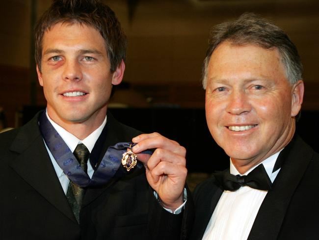 Ben Cousins, above with father Bryan after winning the 2005 Brownlow Medal, is regarded as one of the 50 greatest AFL players.
