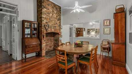 The kitchen and dining area in the home at 29 Rockbourne Tce, Paddington, before the renovation.