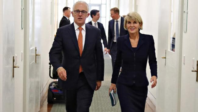 Malcolm Turnbull takes a last walk with Julie Bishop before Scott Morrison was elected as the new prime minister. Picture: David Gray.
