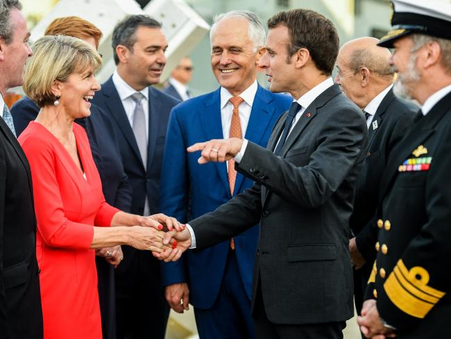 French President Emmanuel Macron greets Julie Bishop as Malcolm Turnbull looks on at Garden Island in May this year. Picture: Brendan Esposito.