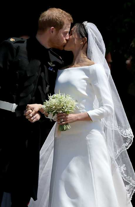 Prince Harry shares a kiss with his new wife Meghan Markle after their wedding at St George's Chapel at Windsor Castle in May. Picture: Getty