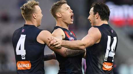 James Harmes, Jake Melksham and Michael Hibberd celebrate a goal.