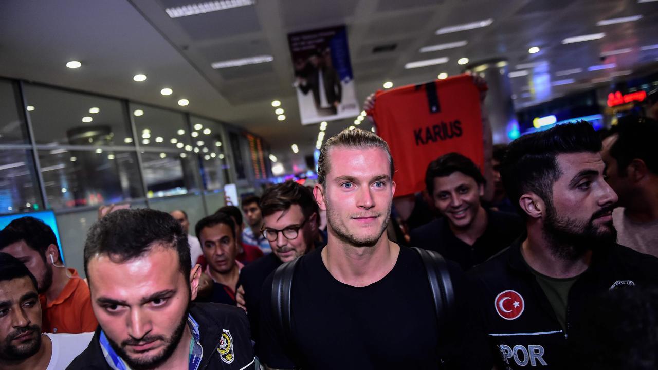 German goalkeeper Loris Karius (C) reacts as he arrives at the Ataturk International Airport in Istanbul to play with Besiktas