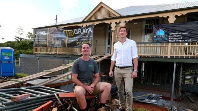 Brothers Rob (left) and Andrew Gray outside the home at 29 Rockbourne Tce, Paddington, when they started the renovation. Picture: AAP/David Clark.