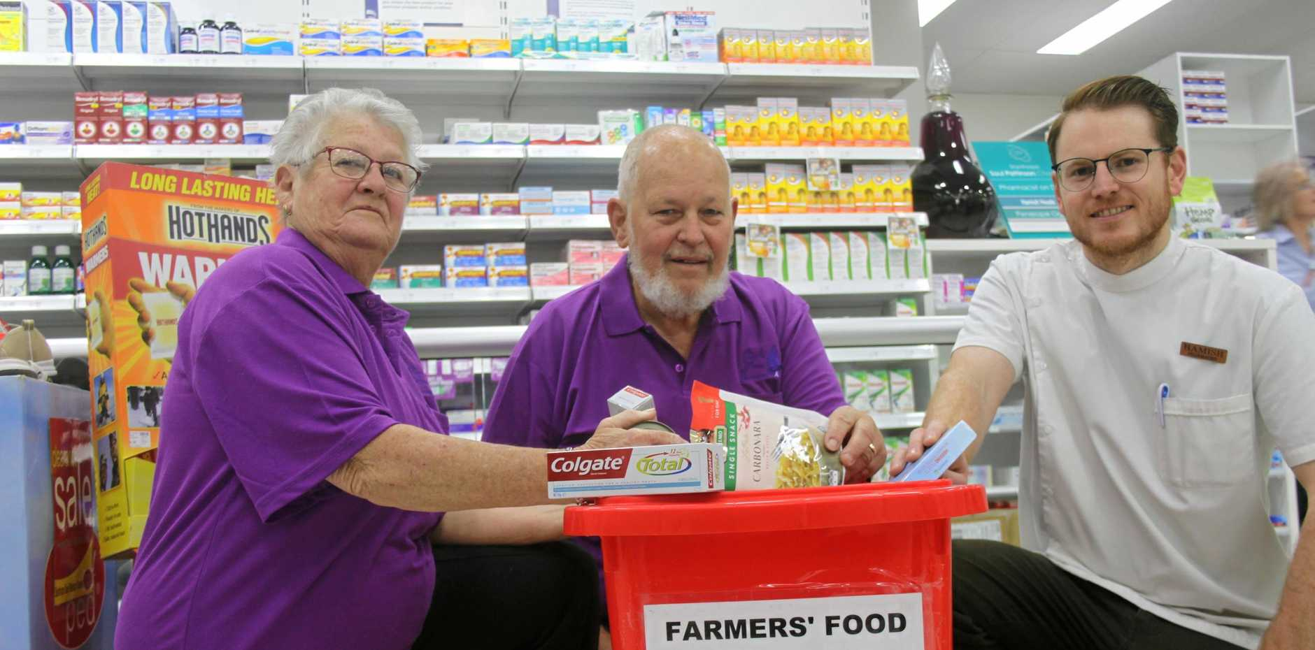 DRIVEN: Chris and Ian Robin with Hamish Heads donating goods at Soul Pattinson Chemist.