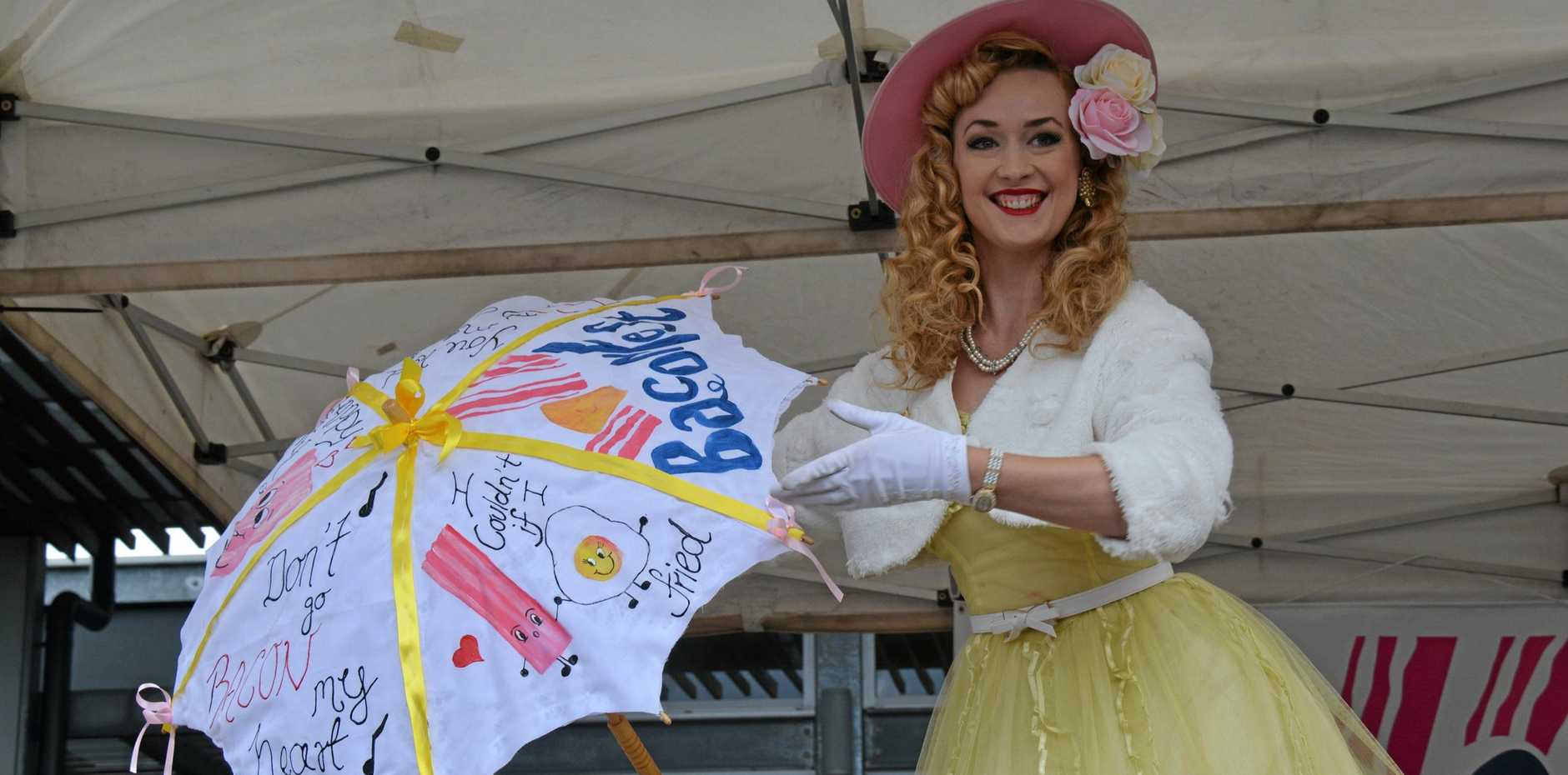 PIN-UP: Miss Kingaroy BaonFest contestant Curley Sue prepares for the rain during the BaconFest weekend in Kingaroy.