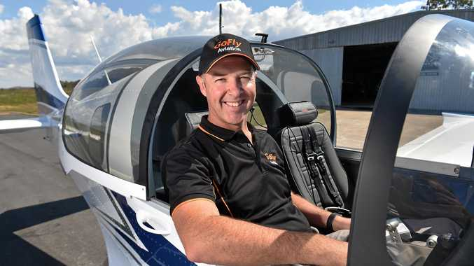 JETTING OFF: Caloundra chief pilot Damiem Wills of GoFly Aviation with a Slingshot Two aircraft ready to take it for a spin.