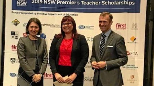 (L-R) The Premier, Gladys Berejiklian awarded Alstonville Public School acting principal Kirstin Beck with a Premier's Commonwealth Bank STEM Scholarship on August 14 at The MInt in Sydney. Pictured with them is Education Minister Rob Stokes.