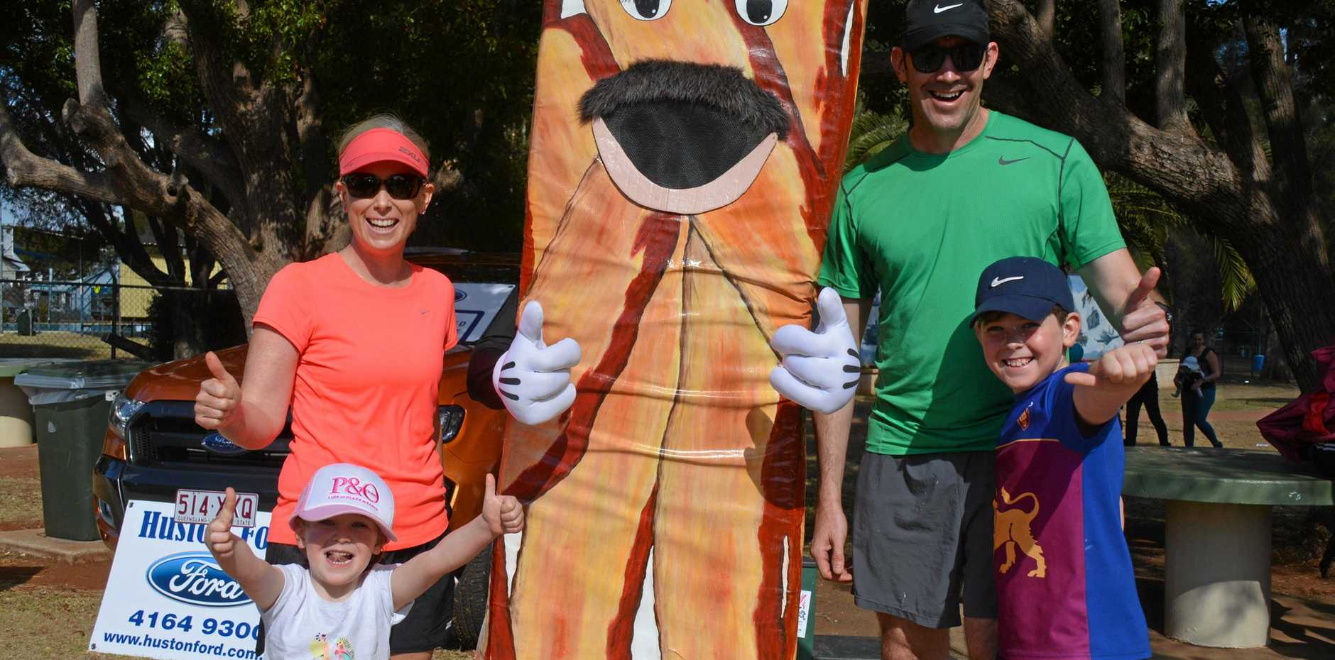 BACON RUN: Carmen, Elliana, Craig and William Campbell with Baconman before the Rail Trail Rasher's Run during Kingaroy BaconFest on August 25 2018.