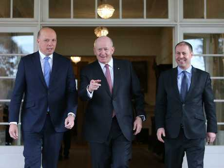 Peter Dutton with General Sir Peter Cosgrove and Treasurer Josh Frydenberg at the ceremony this morning. Photo: Kym Smith