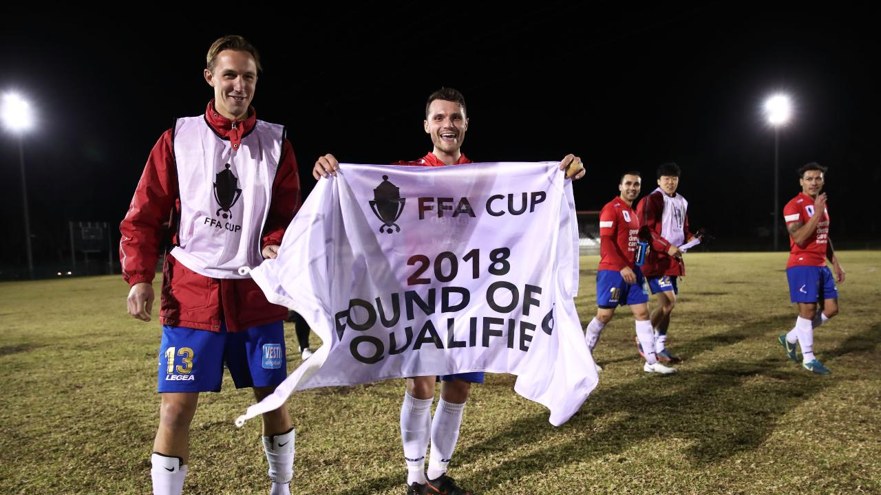 James Mckenzie (L) and Samuel Gallaway (R) of Bonnyrigg White Eagles FC celebrate after reaching the FFA Cup Round of 16