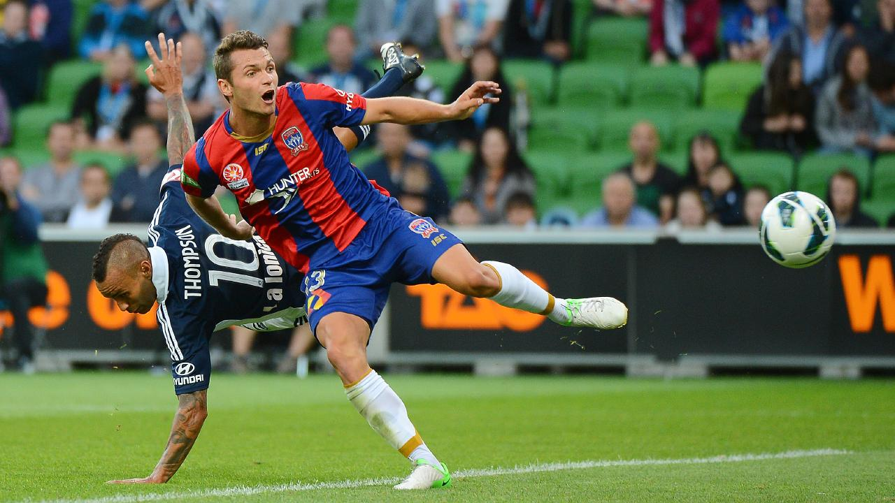 Gallaway tangles with Archie Thompson while in action for Newcastle Jets