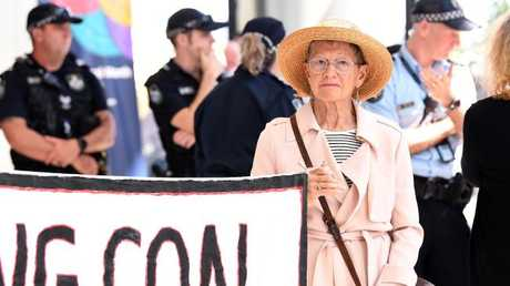 Adani protestors are seen occupying the foyer of the Queensland Government headquarters at 1 William Street in Brisbane. Picture: AAP/Dave Hunt