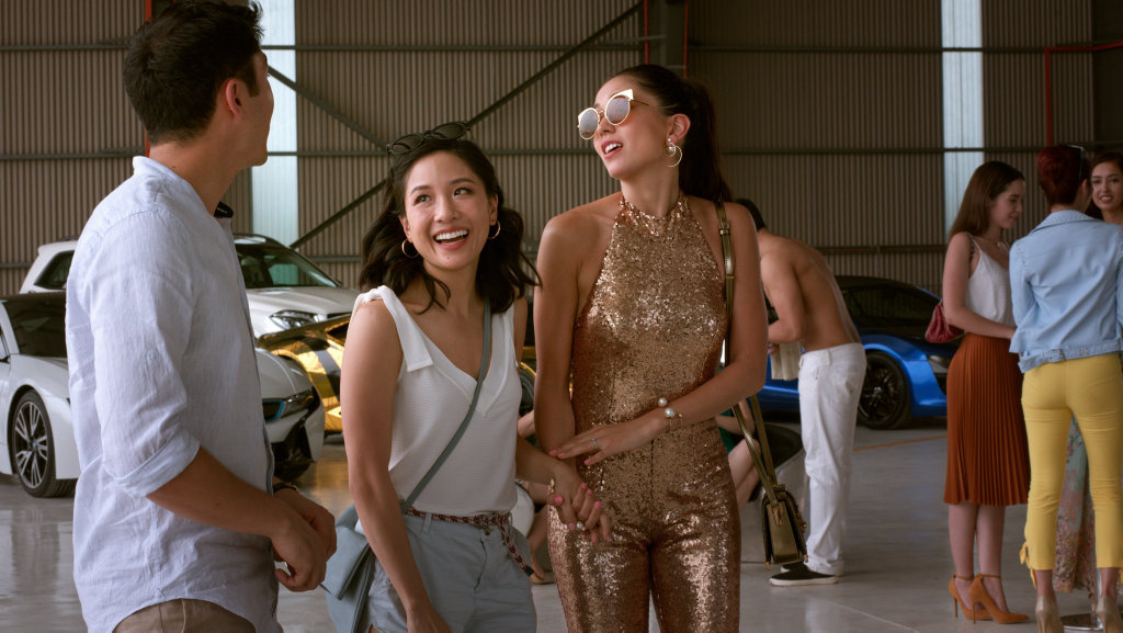 Henry Golding, Constance Wu and Sonoya Mizuno in a scene from Crazy Rich Asians.