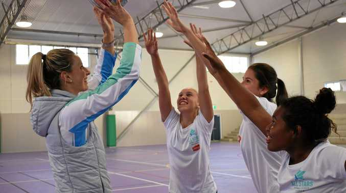 OUT OF REACH: Laura Geitz with Michelle Bobby, Grace Taylor and Chloe Harm at the All Stars Netball Clinic.