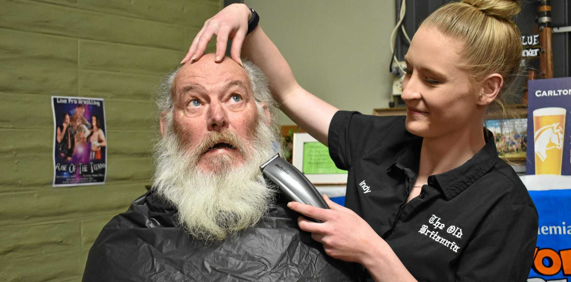 OFF IT GOES: Tom Byrne prepares to face the World's Greatest Shave with Indy Littlemore.