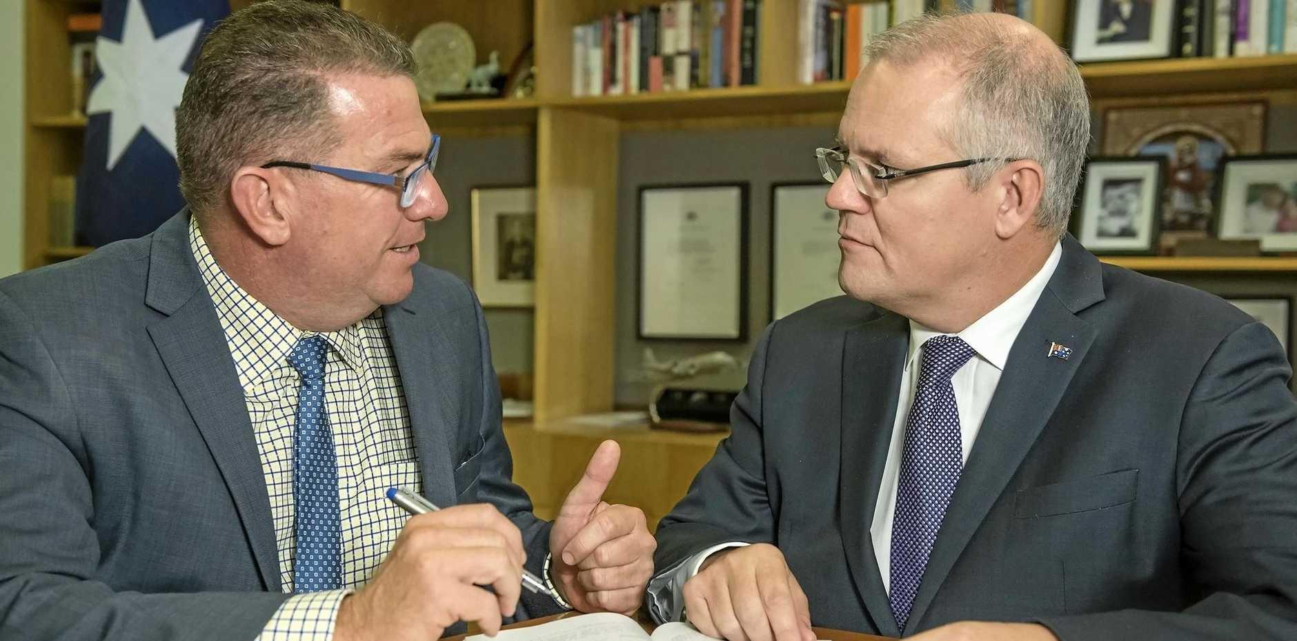 PROMOTION: Federal Member for Wright Scott Buchholz with Prime Minister Scott Morrison.
