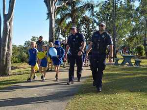 Local police walk students to school for Road Safety Week