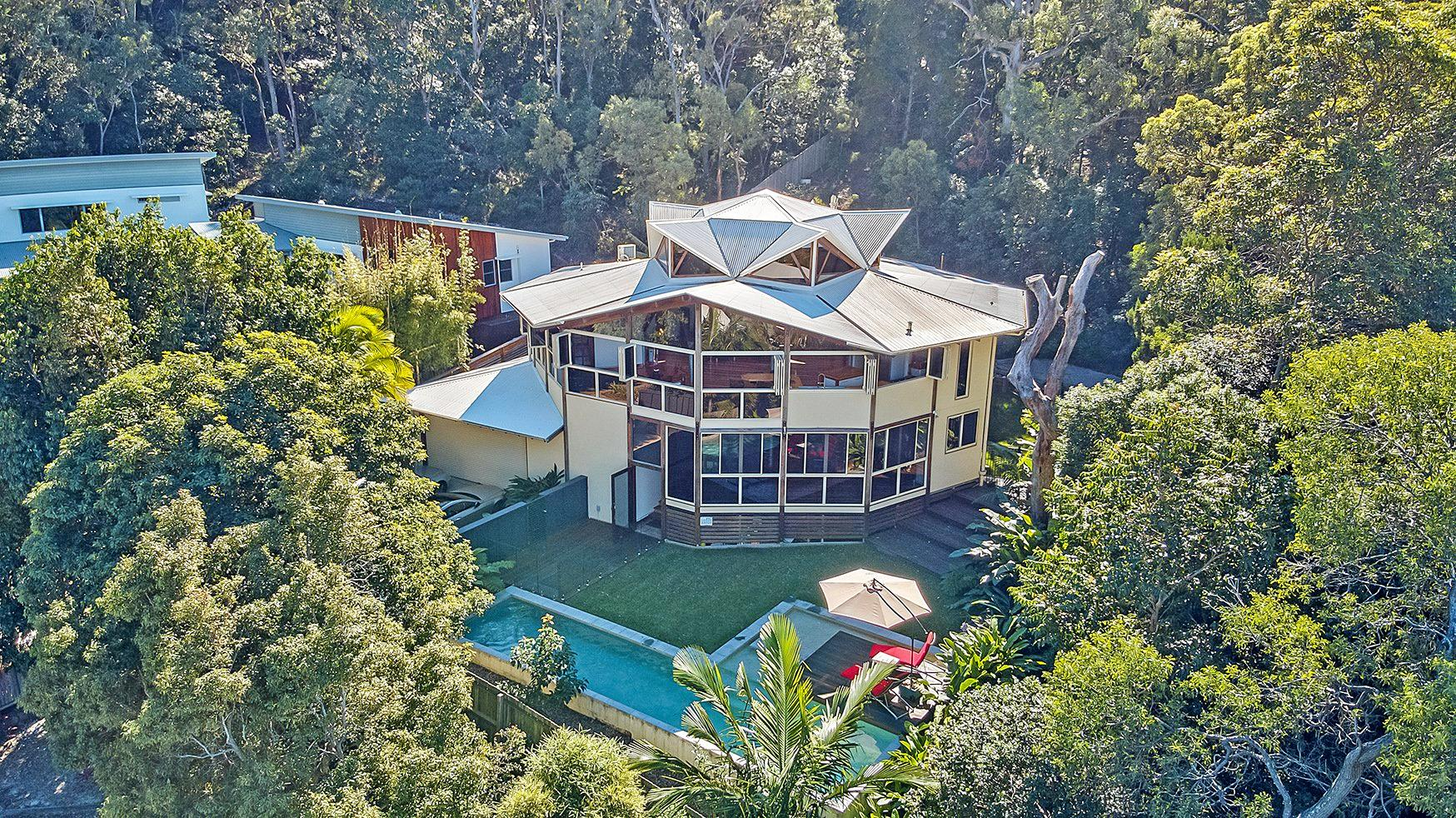 It features five bedrooms, a designer pool, timber deck and an enviable location.