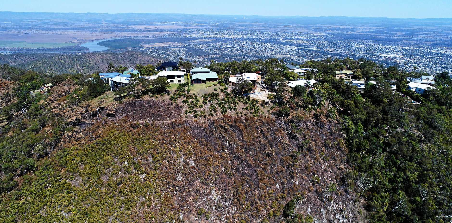 CLOSE ENOUGH: This drone photo of Mt Archer taken yesterday shows close the flames came to houses. during last week's bushfire emergency.