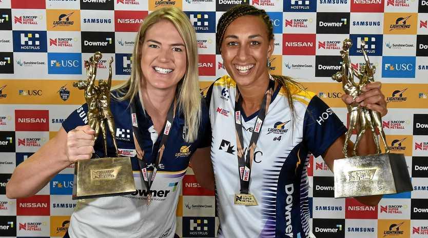 GOLDEN GIRLS: Sunshine Coast Lightning's Caitlin Bassett and Geva Mentor celebrate their grand final victory against West Coast Fever.