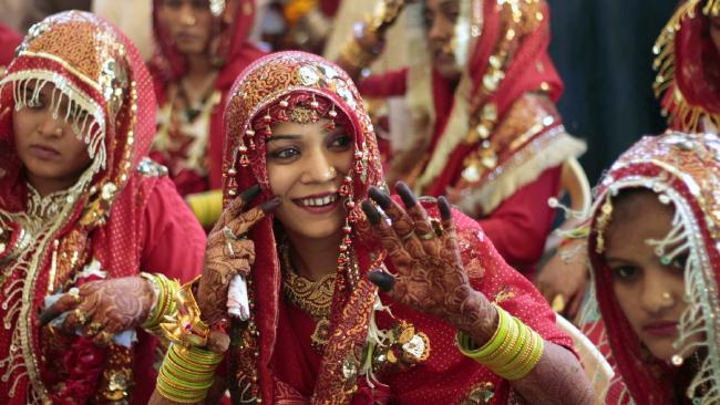 Mass marriages are becoming a common custom to help families meet dowry expectations. (Pic: AP/Ajit Solanki)