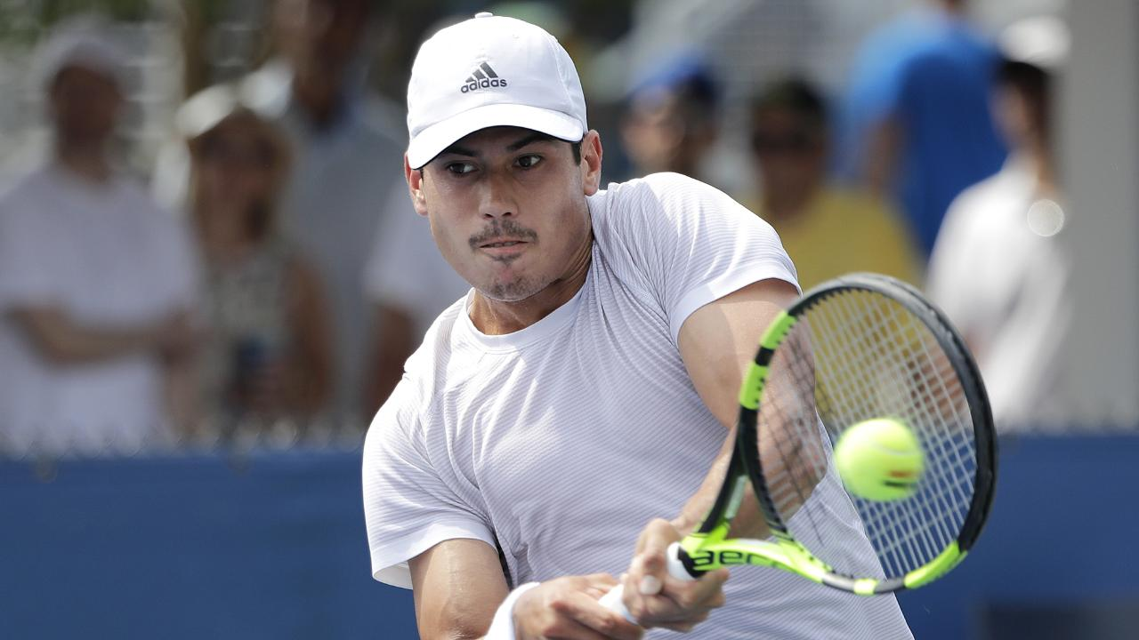 Jason Kubler, of Australia, returns a shot to Roberto Bautista Agut, of Spain, during his US Open first round victory. Picture: AP Photo