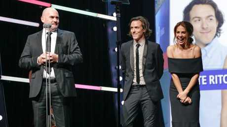 Kate Ritchie, Tim Blackwell and Marty Sheargold accepting their award for Best On Air Team MetroFM at the ACRA Awards in 2016.