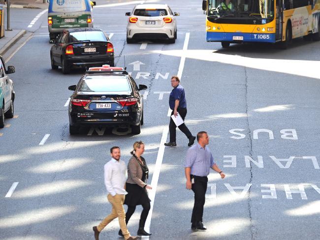 People jaywalking in Brisbane's CBD. Picture: John Gass/AAP
