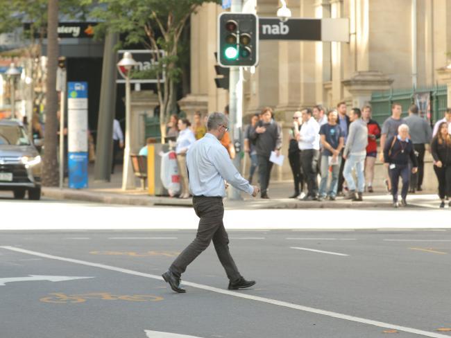 People jaywalking in Brisbane's CBD. Picture: Mark Cranitch