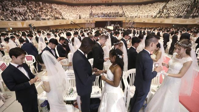 The mass wedding was arranged by Hak Ja Han Moon, wife of the late Rev Sun Myung Moon, the controversial founder of the Unification Church. Picture: AP Photo/Ahn Young-joon