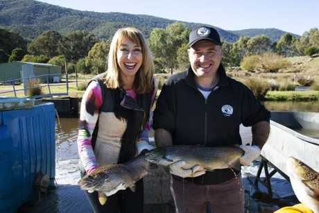 Maeve O'Meara with the fish that produce Yarra Valley caviar in a scene from Food Safari Water.