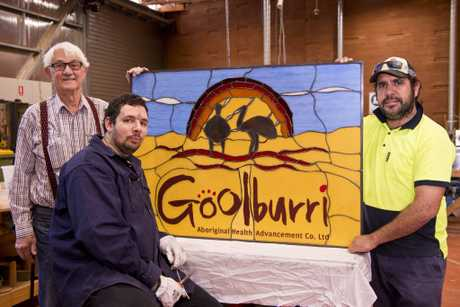 Happy with their hard work from the stained glass leadlight project are (from left) instructor Richard Apel, Nathan Charles and Leslie Martin for Goolburri Aboriginal Health Advancement and Carbal Medical Services in partnership with Cobb and Co Museum, Tuesday, August 28, 2018.