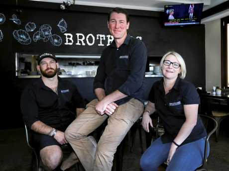 Daniel John, Brad Butson and Mary Ann Butson inside their new business Brothers Cafe and Bar in Kingscliff.