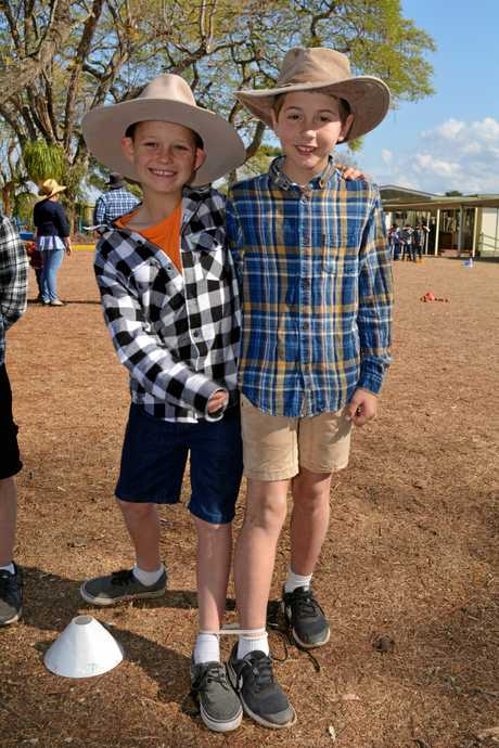 HELP OUT: Students Deagan Smith and Declan Fowler dress up as farmers and donate to a drought appeal.