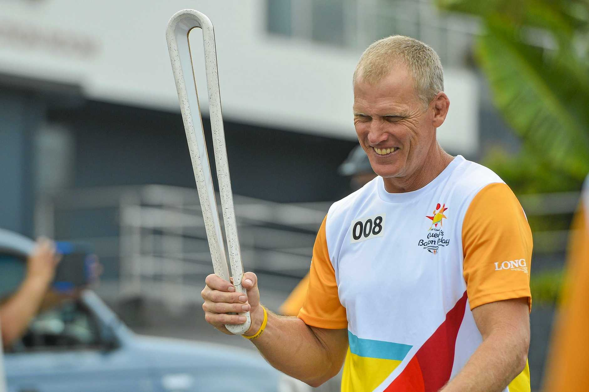 Gary Larson runs the Queen's Baton during the Queen's Baton Relay in Gladstone, for the upcoming 21st Commonwealth Games to be held on the Gold Coast in Australia. 24 March, 2018.