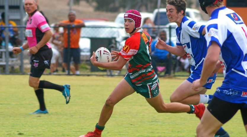 ON THE RUN: A Bulldogs' player makes a break in the under-16 clash against Nanango.