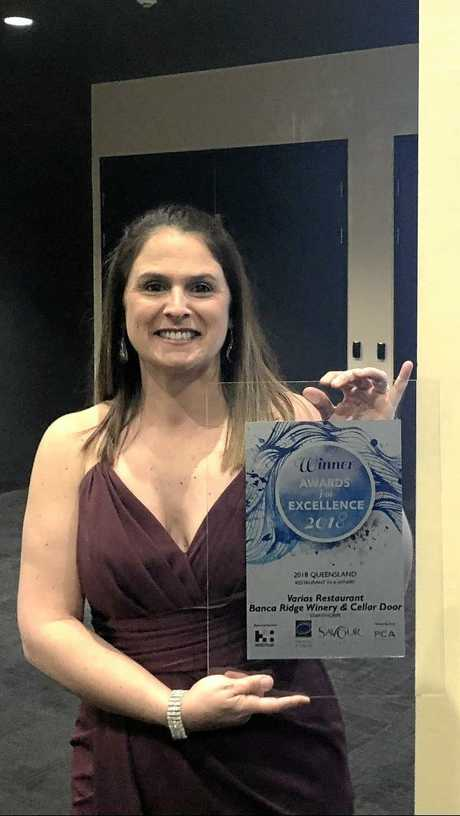 QCWT campus manager Chrissy Mattiazzi with the restaurant's latest award.